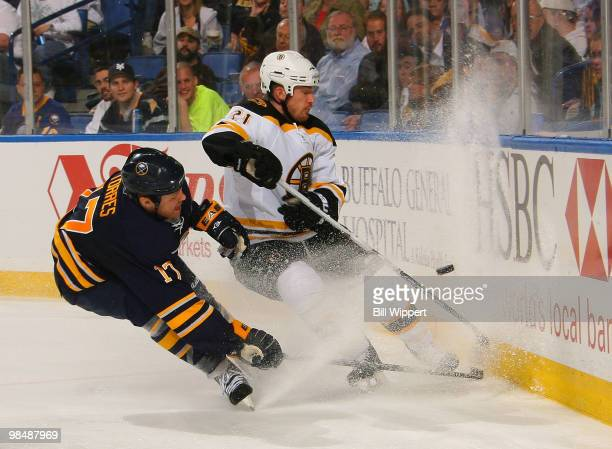 Raffi Torres of the Buffalo Sabres chases down a puck against Andrew Ference of the Boston Bruins in Game One of the Eastern Conference Quarterfinals...