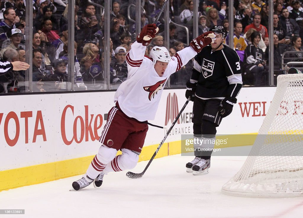 Raffi Torres of the Phoenix Coyotes celebrates his first period goal as Jack Johnson of the Los Angeles Kings looks on during the NHL game at Staples...