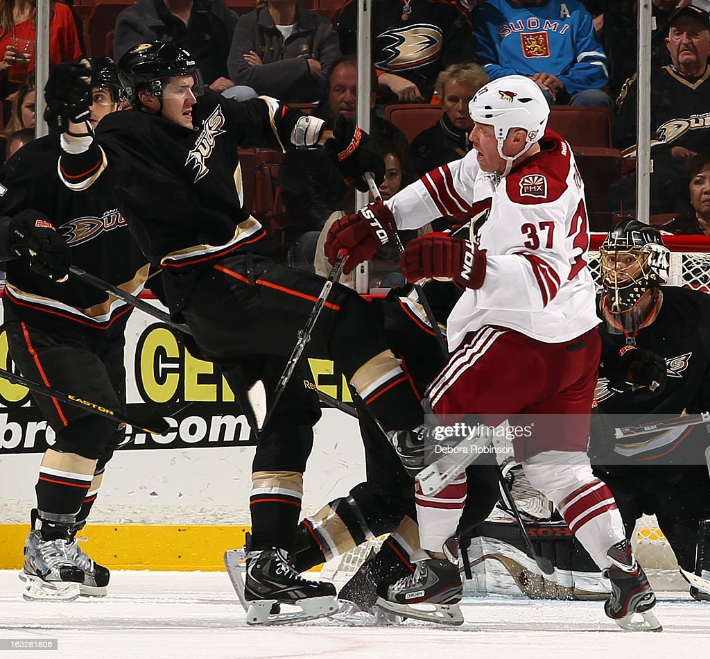 <a gi-track='captionPersonalityLinkClicked' href=/galleries/search?phrase=Raffi+Torres&family=editorial&specificpeople=204612 ng-click='$event.stopPropagation()'>Raffi Torres</a> #37 of the Phoenix Coyotes puts a check on <a gi-track='captionPersonalityLinkClicked' href=/galleries/search?phrase=Ben+Lovejoy&family=editorial&specificpeople=4509565 ng-click='$event.stopPropagation()'>Ben Lovejoy</a> #6 of the Anaheim Ducks on March 6, 2013 at Honda Center in Anaheim, California.