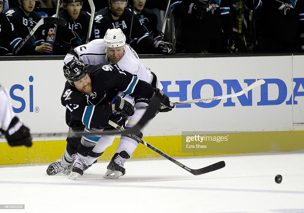 Raffi Torres of the San Jose Sharks and Matt Greene of the Los Angeles Kings go for the puck in Game Seven of the First Round of the 2014 NHL Stanley...