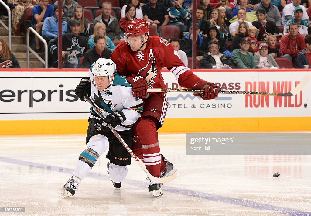 <a gi-track='captionPersonalityLinkClicked' href=/galleries/search?phrase=Raffi+Torres&family=editorial&specificpeople=204612 ng-click='$event.stopPropagation()'>Raffi Torres</a> #13 of the San Jose Sharks can't control the puck as he is checked by <a gi-track='captionPersonalityLinkClicked' href=/galleries/search?phrase=Martin+Hanzal&family=editorial&specificpeople=2109469 ng-click='$event.stopPropagation()'>Martin Hanzal</a> #11 of the Phoenix Coyotes during the third period at Jobing.com Arena on April 24, 2013 in Glendale, Arizona.