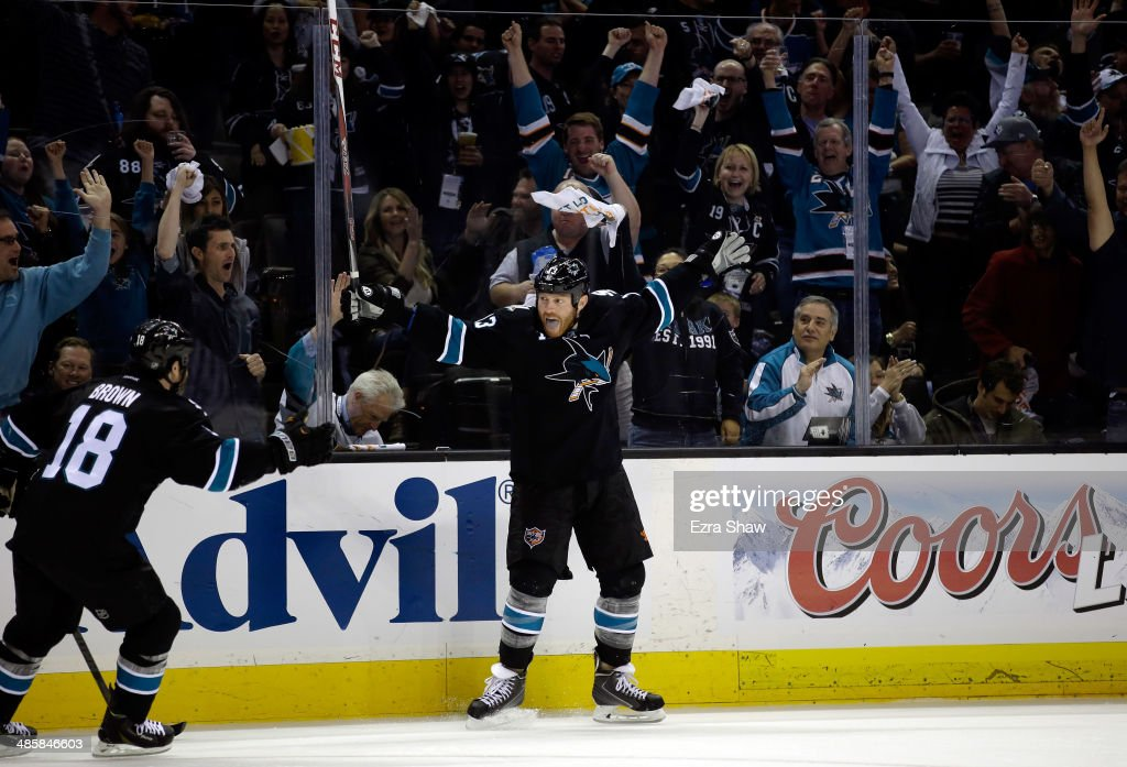 <a gi-track='captionPersonalityLinkClicked' href=/galleries/search?phrase=Raffi+Torres&family=editorial&specificpeople=204612 ng-click='$event.stopPropagation()'>Raffi Torres</a> #13 of the San Jose Sharks celebrates with <a gi-track='captionPersonalityLinkClicked' href=/galleries/search?phrase=Mike+Brown+-+American+Ice+Hockey+Right+Winger&family=editorial&specificpeople=7275813 ng-click='$event.stopPropagation()'>Mike Brown</a> #18 after he scored a goal in the second period of their game against the Los Angeles Kings in Game Two of the First Round of the 2014 NHL Stanley Cup Playoffs at SAP Center on April 20, 2014 in San Jose, California.
