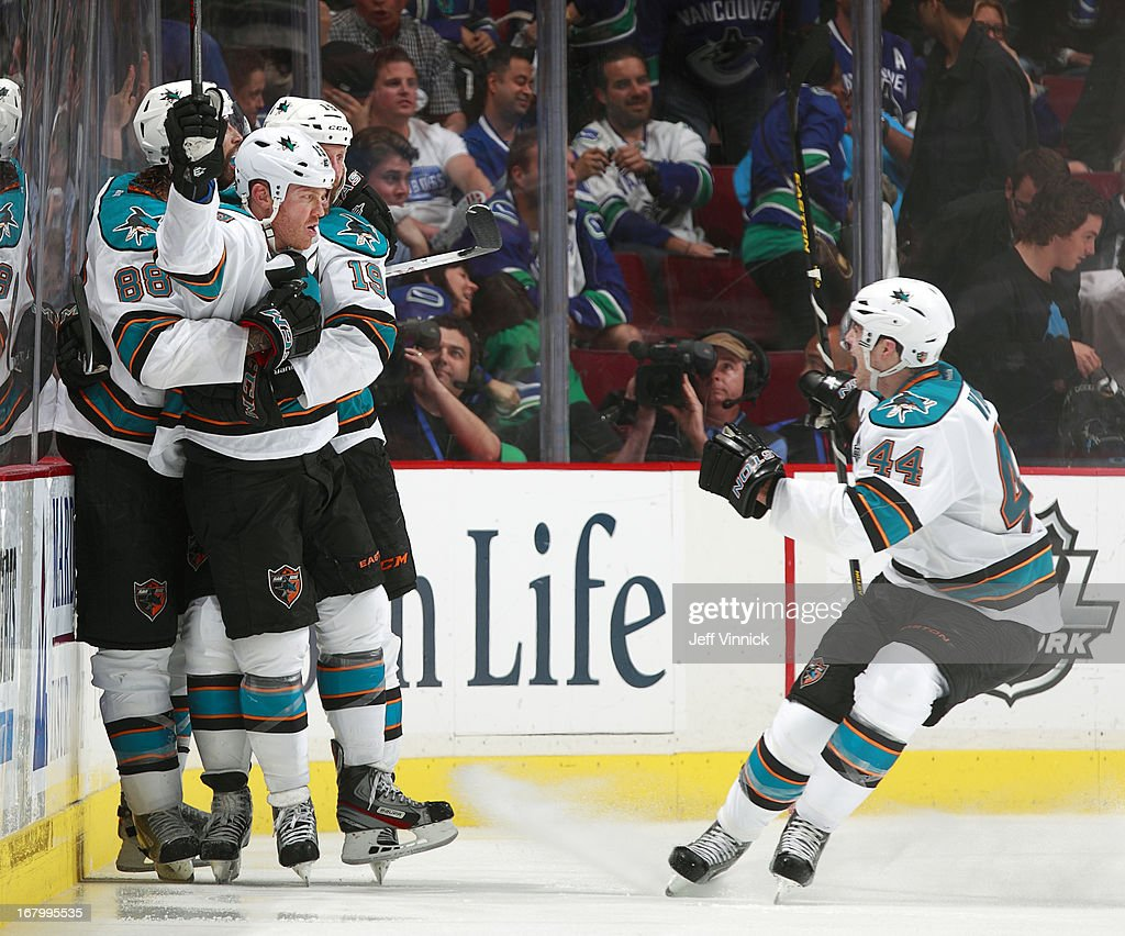 <a gi-track='captionPersonalityLinkClicked' href=/galleries/search?phrase=Raffi+Torres&family=editorial&specificpeople=204612 ng-click='$event.stopPropagation()'>Raffi Torres</a> #13 of the San Jose Sharks is mobbed by teammates <a gi-track='captionPersonalityLinkClicked' href=/galleries/search?phrase=Marc-Edouard+Vlasic&family=editorial&specificpeople=880807 ng-click='$event.stopPropagation()'>Marc-Edouard Vlasic</a> #44, <a gi-track='captionPersonalityLinkClicked' href=/galleries/search?phrase=Brent+Burns&family=editorial&specificpeople=212883 ng-click='$event.stopPropagation()'>Brent Burns</a> #88 and <a gi-track='captionPersonalityLinkClicked' href=/galleries/search?phrase=Joe+Thornton&family=editorial&specificpeople=201829 ng-click='$event.stopPropagation()'>Joe Thornton</a> #19 after he scored the game-winning goal in overtime against the Vancouver Canucks in Game Two of the Western Conference Quarterfinals during the 2013 NHL Stanley Cup Playoffs at Rogers Arena on May 3, 2013 in Vancouver, British Columbia, Canada. San Jose won 3-2 in overtime.