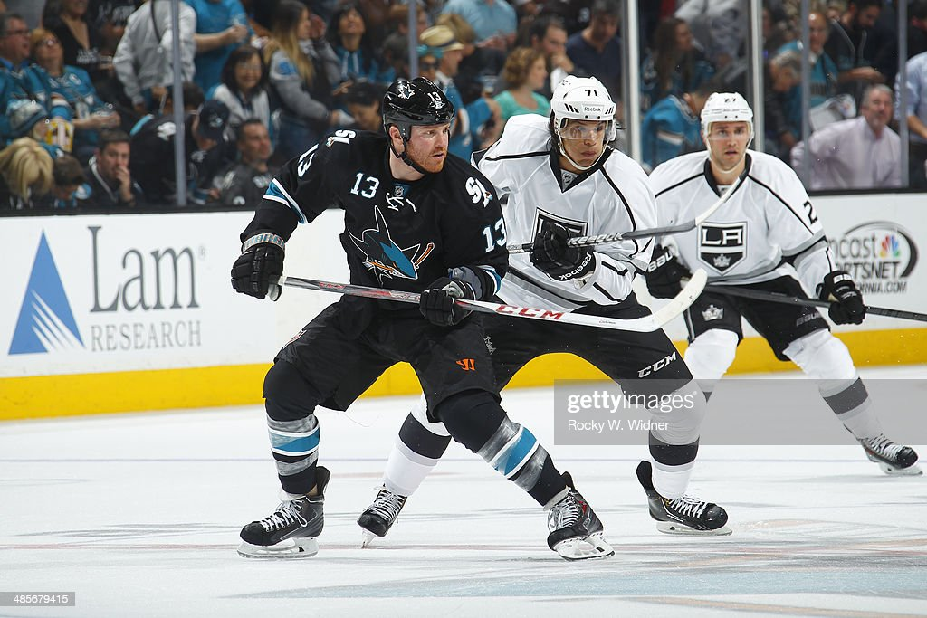 <a gi-track='captionPersonalityLinkClicked' href=/galleries/search?phrase=Raffi+Torres&family=editorial&specificpeople=204612 ng-click='$event.stopPropagation()'>Raffi Torres</a> #13 of the San Jose Sharks skates against <a gi-track='captionPersonalityLinkClicked' href=/galleries/search?phrase=Jordan+Nolan&family=editorial&specificpeople=4161890 ng-click='$event.stopPropagation()'>Jordan Nolan</a> #71 of the Los Angeles Kings in Game One of the First Round of the 2014 NHL Stanley Cup Playoffs at SAP Center on April 17, 2014 in San Jose, California.