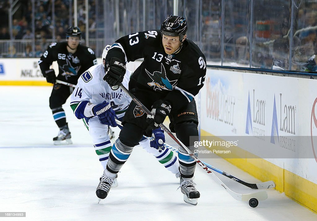 Raffi Torres #13 of the San Jose Sharks skates with the puck ahead of Alex Burrows #14 of the Vancouver Canucks in Game Three of the Western Conference Quarterfinals during the 2013 NHL Stanley Cup Playoffs at HP Pavilion on May 5, 2013 in San Jose, California. The Sharks defeated the Canucks 5-2.