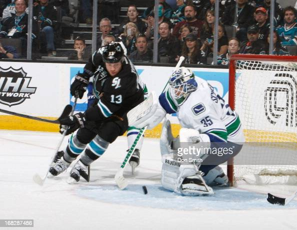 Raffi Torres of the San Jose Sharks tries to score against Cory Schneider of the Vancouver Canucks in Game Four of the Western Conference...