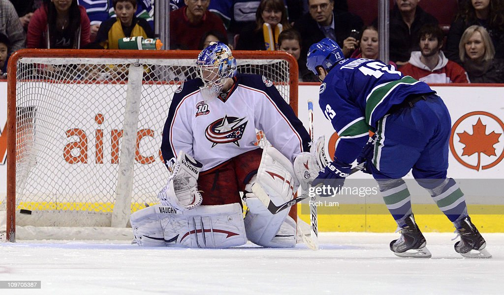 Raffi Torres of the Vancouver Canucks scores on goalie Steve Mason of the Columbus Blue Jackets during the shoot out to win the game in NHL action on...