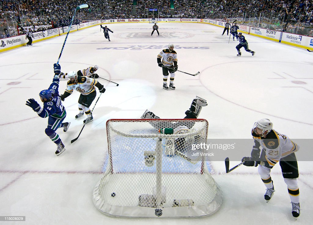 <a gi-track='captionPersonalityLinkClicked' href=/galleries/search?phrase=Raffi+Torres&family=editorial&specificpeople=204612 ng-click='$event.stopPropagation()'>Raffi Torres</a> #13 of the Vancouver Canucks scores with 18 seconds left to go in the third period while Tim Thomas #30, Chris Kelly #23, <a gi-track='captionPersonalityLinkClicked' href=/galleries/search?phrase=Milan+Lucic&family=editorial&specificpeople=537957 ng-click='$event.stopPropagation()'>Milan Lucic</a> #17, <a gi-track='captionPersonalityLinkClicked' href=/galleries/search?phrase=Zdeno+Chara&family=editorial&specificpeople=203177 ng-click='$event.stopPropagation()'>Zdeno Chara</a> #33 and <a gi-track='captionPersonalityLinkClicked' href=/galleries/search?phrase=Johnny+Boychuk&family=editorial&specificpeople=2125695 ng-click='$event.stopPropagation()'>Johnny Boychuk</a> #55 of the Boston Bruins look on in Game One of the 2011 NHL Stanley Cup Finals at Rogers Arena on June 1, 2011 in Vancouver, British Columbia, Canada.