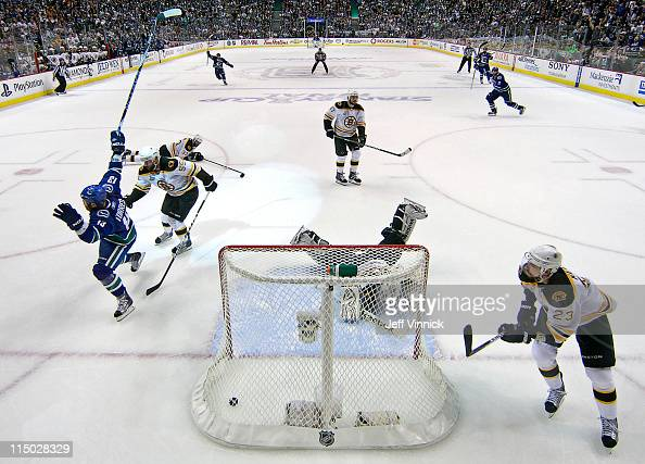 Raffi Torres of the Vancouver Canucks scores with 18 seconds left to go in the third period while Tim Thomas Chris Kelly Milan Lucic Zdeno Chara and...