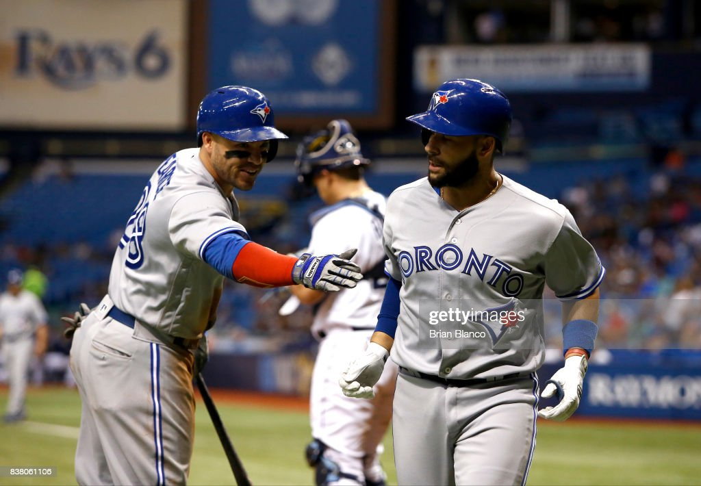 Raffy Lopez #1 of the Toronto Blue Jays celebrates with teammate Steve Pearce #28 after hitting a home run off of pitcher Austin Pruitt of the Tampa Bay Rays during the second inning of a game on August 23, 2017 at Tropicana Field in St. Petersburg, Florida.
