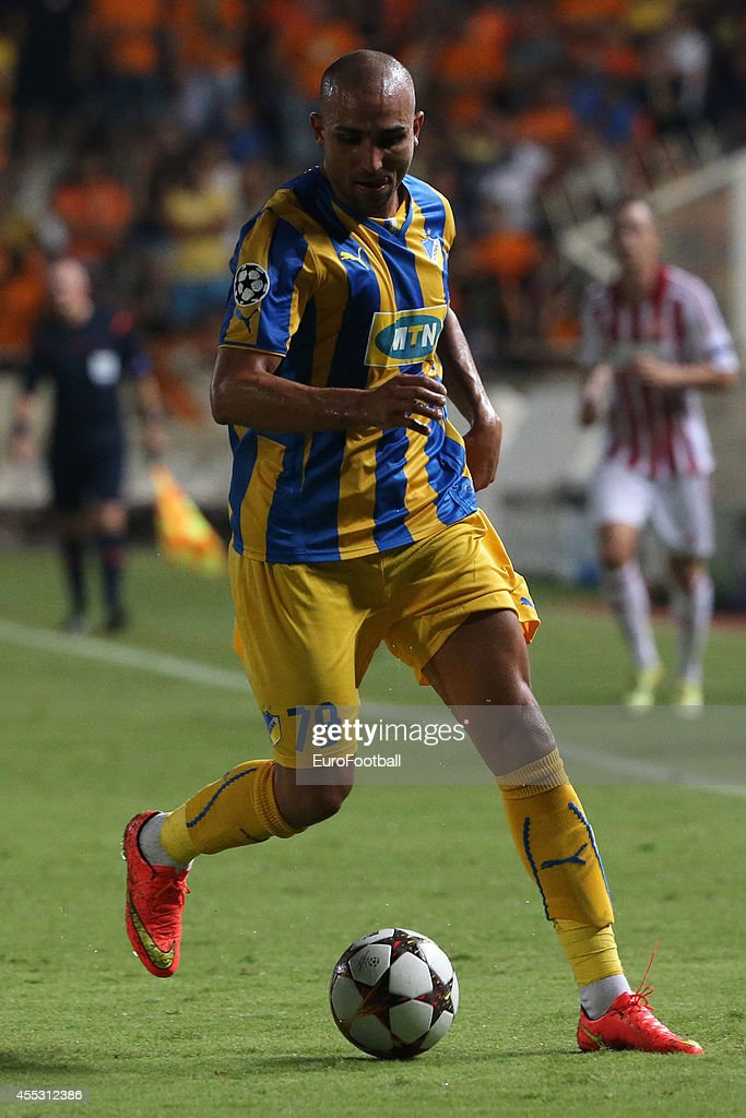 <a gi-track='captionPersonalityLinkClicked' href=/galleries/search?phrase=Rafik+Djebbour&family=editorial&specificpeople=4509033 ng-click='$event.stopPropagation()'>Rafik Djebbour</a> of APOEL in action during the UEFA Champions League play-offs second leg match between APOEL and Aalborg at the GSP Stadium on August 26, 2014 in Nicosia, Cyprus.