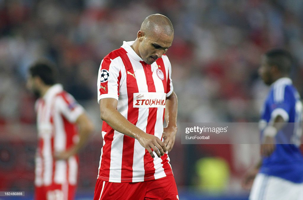 <a gi-track='captionPersonalityLinkClicked' href=/galleries/search?phrase=Rafik+Djebbour&family=editorial&specificpeople=4509033 ng-click='$event.stopPropagation()'>Rafik Djebbour</a> of Olympiacos FC in action during the UEFA Champions League group stage match between Olympiacos FC and FC Schalke 04 at the Karaiskakis Stadium on September 18, 2012 in Piraeus, Greece.