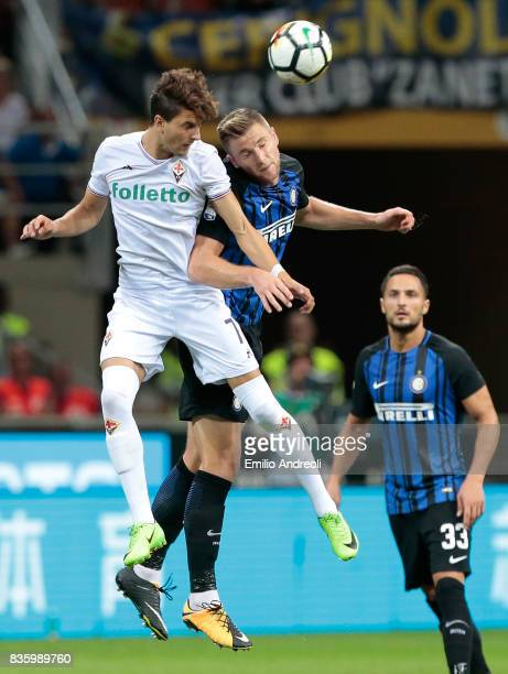 Rafik Zekhnini of ACF Fiorentina jumps for the ball with Milan Skriniar of FC Internazionale Milano during the Serie A match between FC...