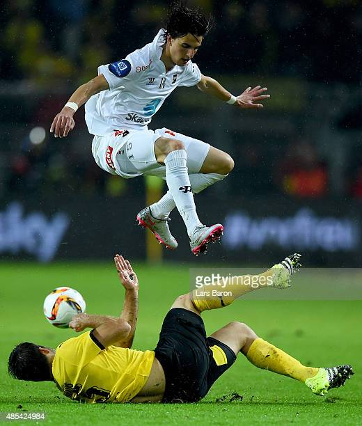 Rafik Zekhnini of Odd jumps over Sokratis Papastathopoulos of Borussia Dortmund during the UEFA Europa League Play Off Round 2nd Leg match between...