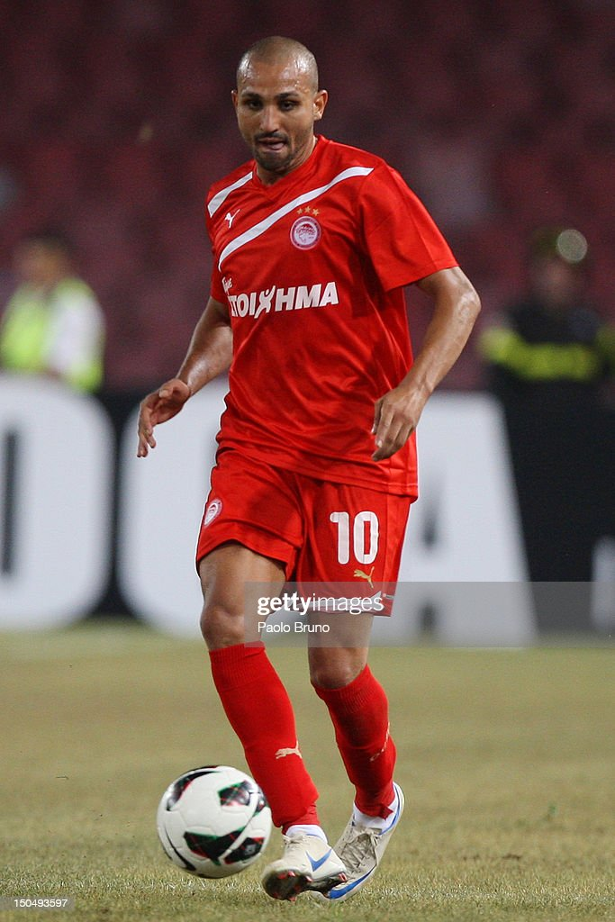 Rafik Zoheir Djebbour of Olympiacos in action during the pre-season friendly match between SSC Napoli and Olympiacos at Stadio San Paolo on August 19, 2012 in Naples, Italy.
