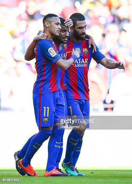 Rafinha Alcantara of FC Barcelona celebrates with his team mates Neymar Jr and Ardan Turan after scoring his team's first goalduring the La Liga...