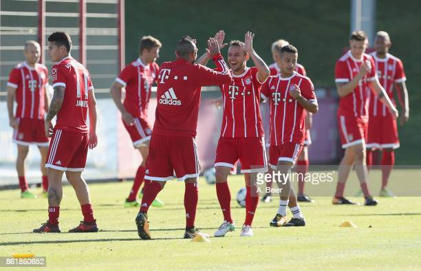 Rafinha and Arturo Vidal of FC Bayern Muenchen joke during a training session at Saebener Strasse training ground on October 16 2017 in Munich Germany