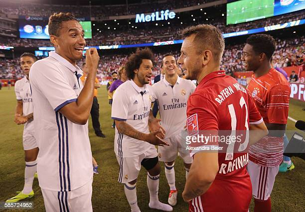 Rafinha and David Alaba of Bayern Muenchen chat with Danilo Luiz Da Silva and Marcelo of Real Madrid during the International Champions Cup match...