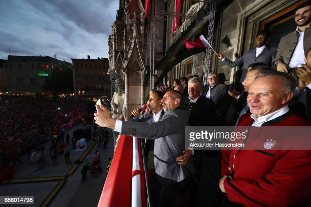 Rafinha and Franck Ribery of Bayern Muenchen speaks to the fans as they celebrate winning the 67th German Championship title on the town hall balcony...