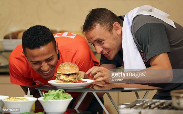 Rafinha and Thiago of FC Bayern Muenchen inspect their selfmade burgers in a activity session during the Audi Summer Tour USA 2016 on July 26 2016 in...