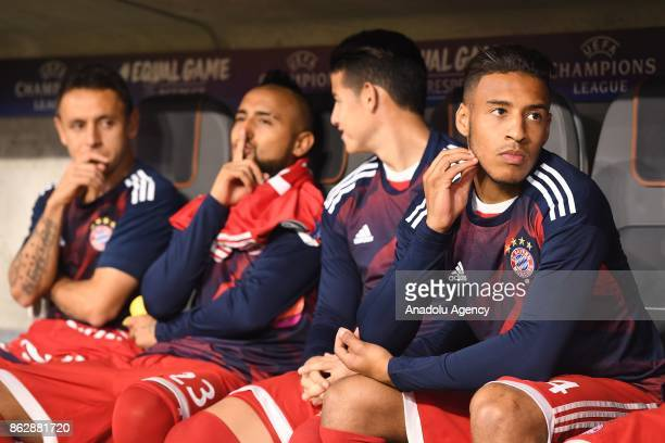 Rafinha Arturo Vidal James Rodriguez and Corentin Tolisso of Bayern Munich are seen on the bench during UEFA the Champions League group B soccer...