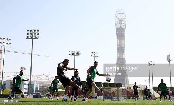 Rafinha is challenged by Robert Lewandowski during a training session at day 2 of the Bayern Muenchen training camp at Aspire Academy on January 4...