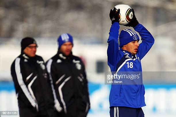 Rafinha is seen infront of head coach Felix Magath and assistant coach Bernd Hollerbach during a Schalke 04 training session on January 26 2010 in...