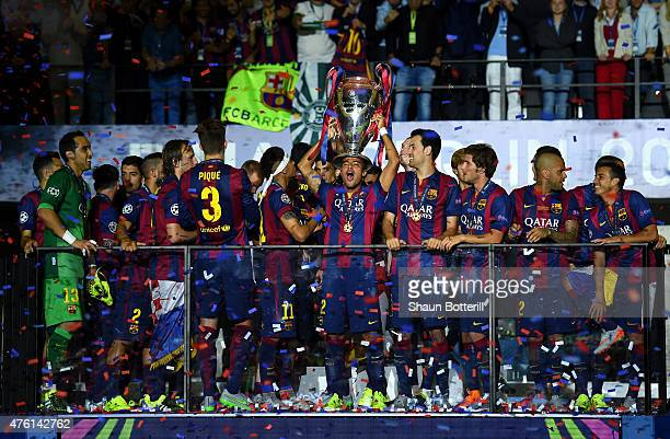 Rafinha of Barcelona celebrates with the trophy after the UEFA Champions League Final between Juventus and FC Barcelona at Olympiastadion on June 6...
