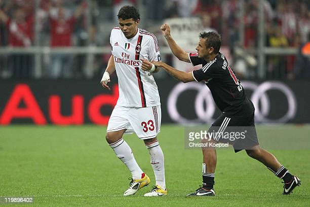 Rafinha of Bayern hits Silva Thiago of AC Milan after winning the Audi Cup match between FC Bayern Muenchen and AC Milan at Allianz Arena on July 26...