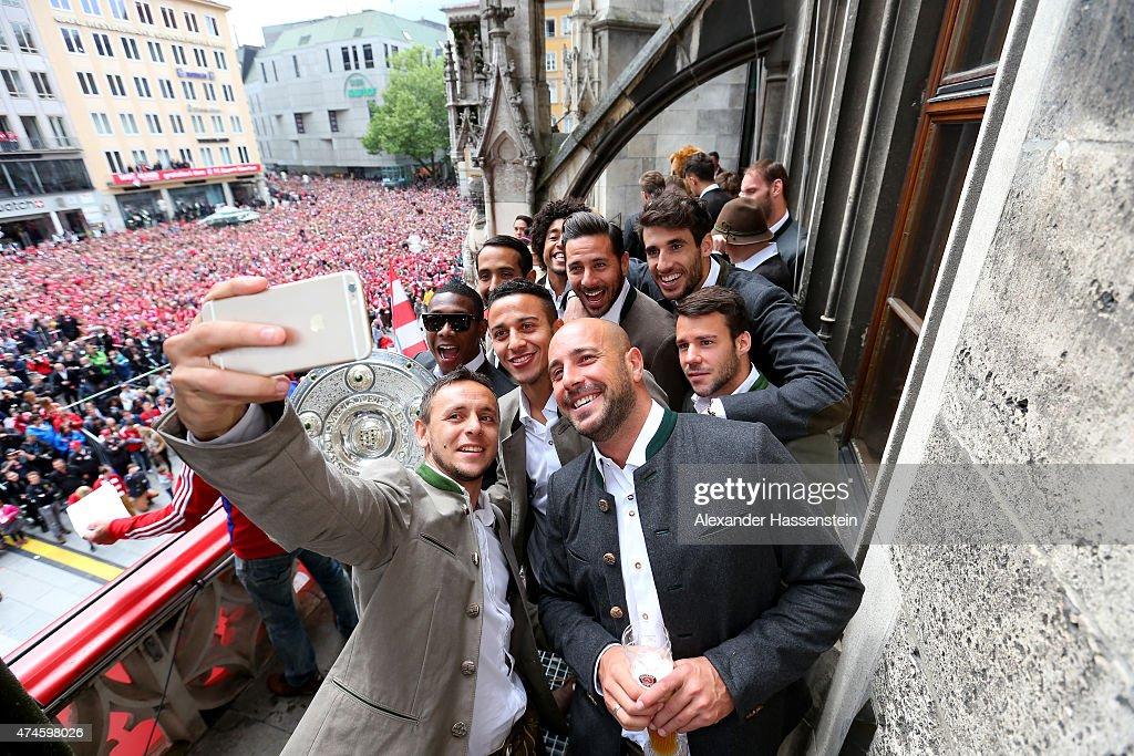 Rafinha of Bayern Muenchen and his team mates David Alaba Medhi Benatia Tiago Dante Pepe Reina Claudio Pizarro Javier Martinez and Juan Bernat as the...