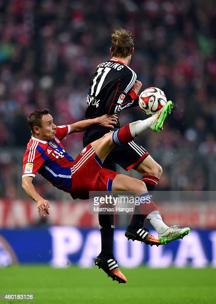 Rafinha of Bayern Muenchen and Stephan Kiessling of Bayer Leverkusen compete for the ball during the Bundesliga match between FC Bayern Muenchen and...