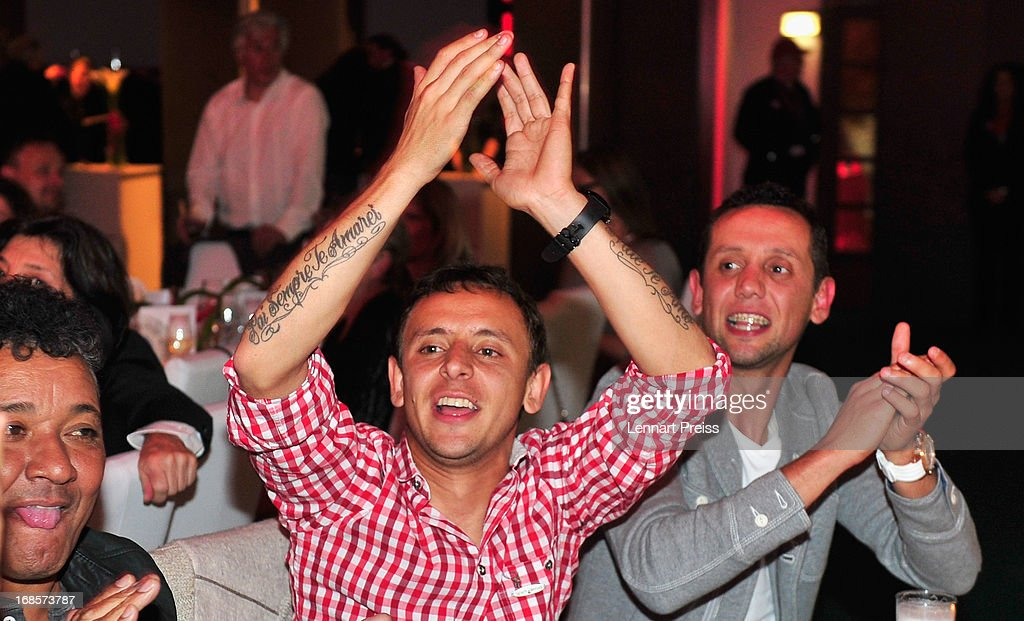 Rafinha (C) of Bayern Muenchen celebrates winning the German championship during the Official Champion dinner at Postpalast on May 12, 2013 in Munich, Germany.