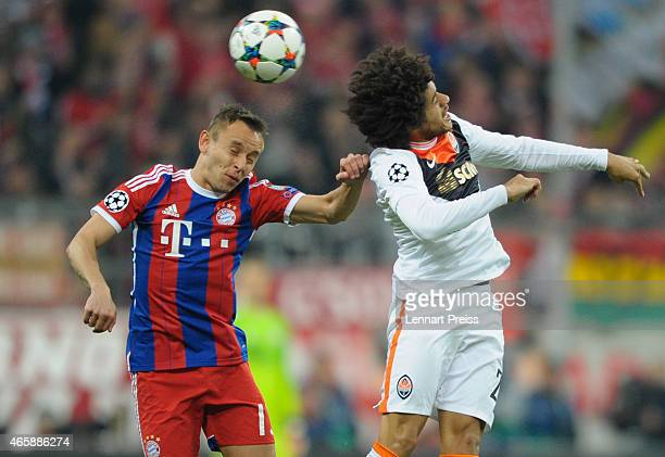 Rafinha of Bayern Muenchen challenges Taison of Shakhtar Donetsk during the UEFA Champions League Round of 16 second leg match between FC Bayern...
