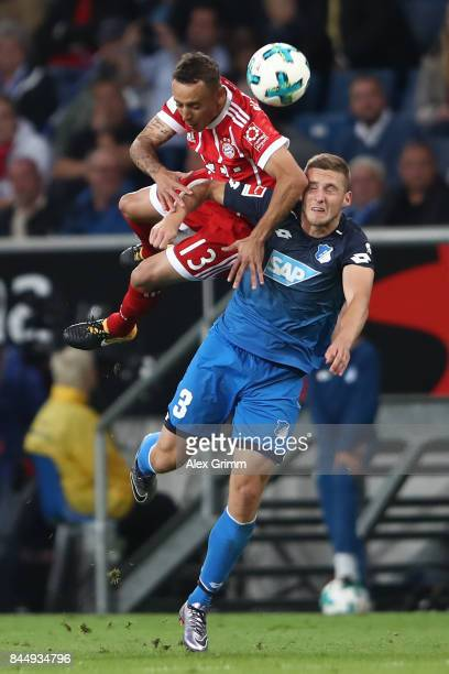 Rafinha of Bayern Muenchen fights for the ball with Pavel Kaderabek of Hoffenheim during the Bundesliga match between TSG 1899 Hoffenheim and FC...