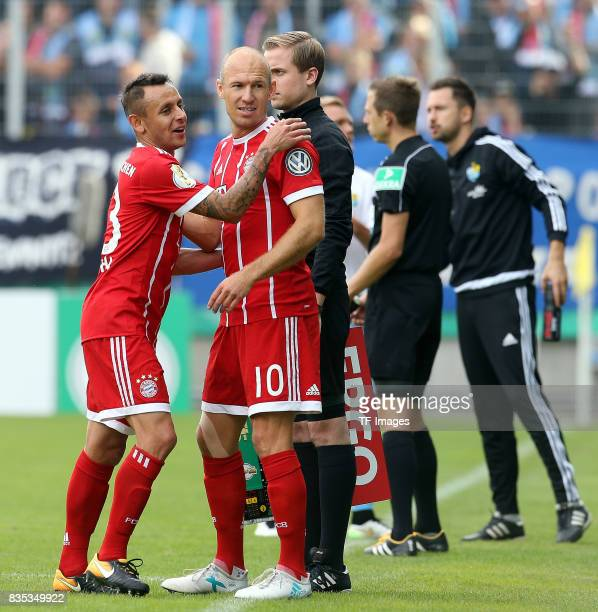 Rafinha of Bayern Muenchen shakes hands with Arjen Robben of Bayern Muenchen during the DFB Cup first round match between Chemnitzer FC and FC Bayern...