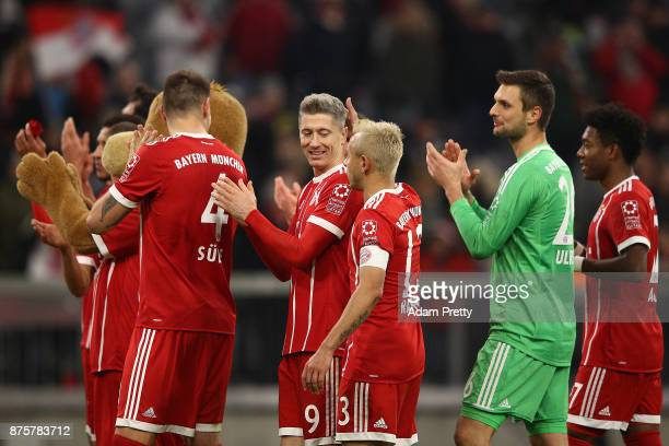 Rafinha of Bayern Muenchen slaps the head of Robert Lewandowski of Bayern Muenchen after the Bundesliga match between FC Bayern Muenchen and FC...