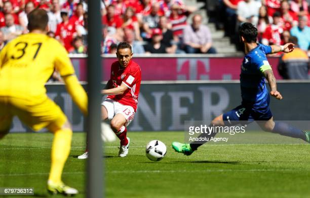 Rafinha of Bayern Munich tries to score against Aytac Sulu of Darmstadt during the Bundesliga first division soccer match between Bayern Munich and...