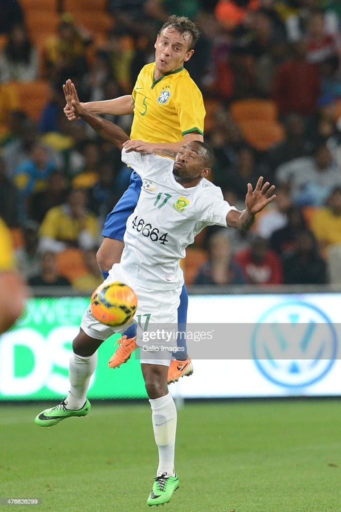 Rafinha of Brazil and Bernard Parker of South Africa during the International Friendly match between South Africa and Brazil at FNB Stadium on March 05, 2014 in Johannesburg, South Africa.