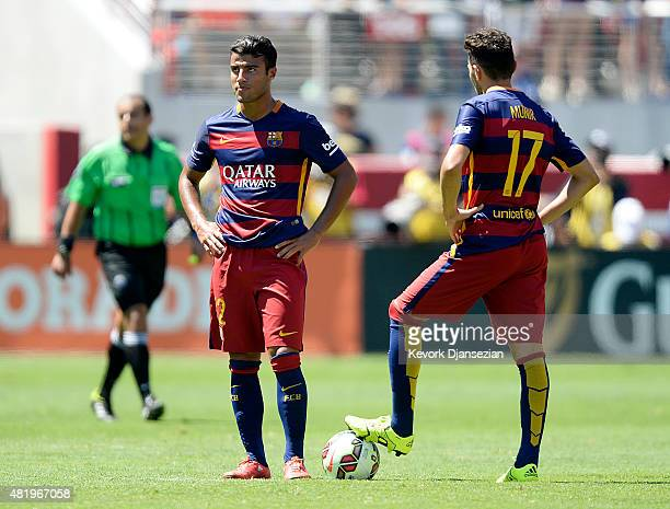 Rafinha of FC Barcelona and teammate Munir El Haddadi react after Adnan Januzaj of Manchester United scored during the second half of the...
