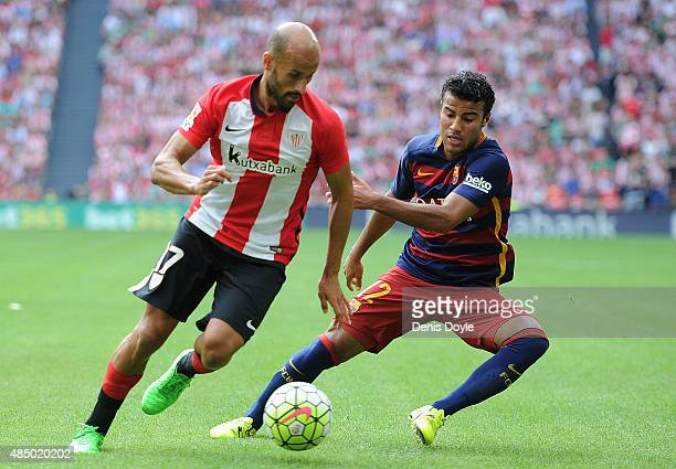 Rafinha of FC Barcelona battles for the ball against Mikel Rico of Athletic Club during the La Liga match between Athletic Club and FC Barcelona at...