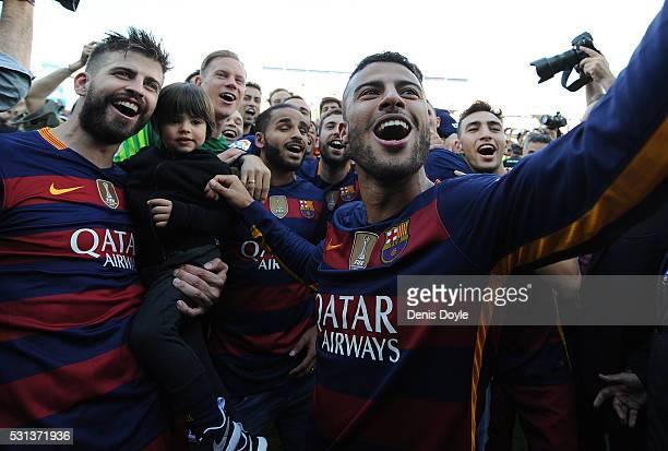 Rafinha of FC Barcelona celebrates with Gerard Pique after beating Granada CF 03 to clinch the La Liga title during the La Liga match between Granada...