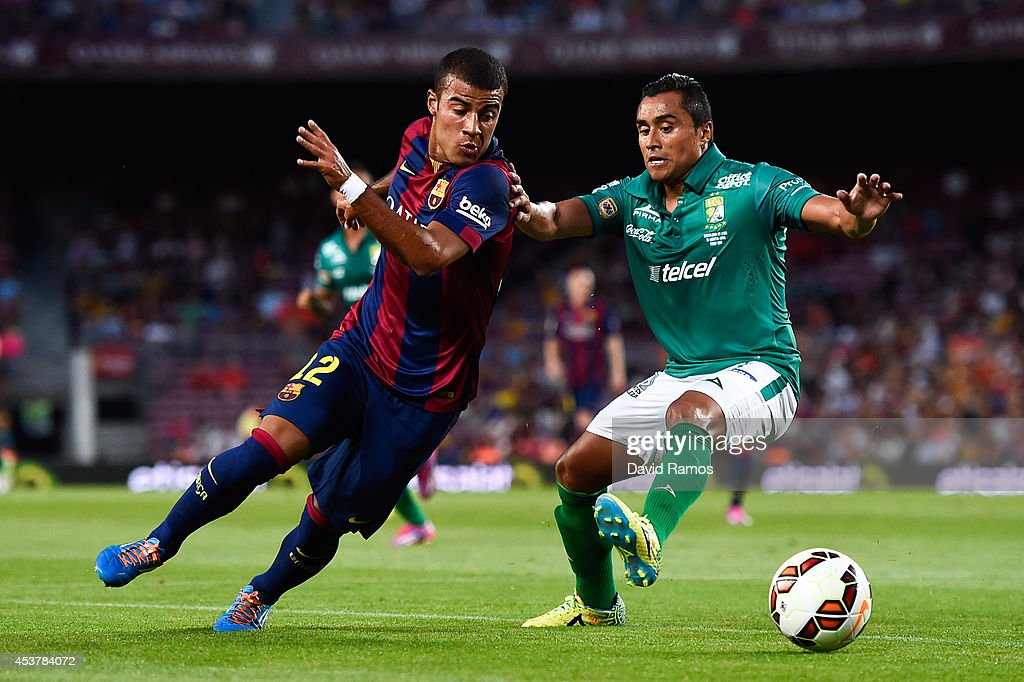Rafinha of FC Barcelona competes for the ball with Edwin Hernandez of Club Leon during the Joan Gamper Trophy match between FC Barcelona and Club Leon at Camp Nou on August 18, 2014 in Barcelona, Spain.
