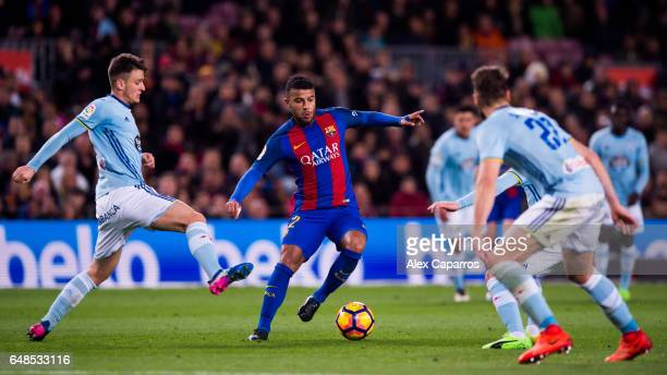 Rafinha of FC Barcelona dribbles Nemanja Radoja of RC Celta de Vigo during the La Liga match between FC Barcelona and RC Celta de Vigo at Camp Nou...