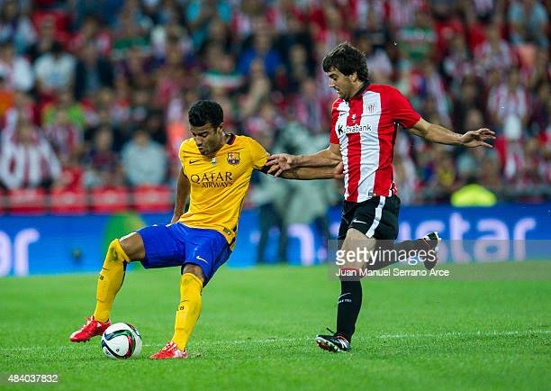 Rafinha of FC Barcelona duels for the ball with Mikel San Jose of Athletic Club during the Super Cup first leg match between of Athletic Club and FC...