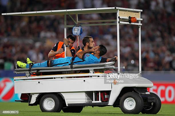 Rafinha of FC Barcelona is injured during the UEFA Champions League Group E match between AS Roma and FC Barcelona at Stadio Olimpico on September 16...