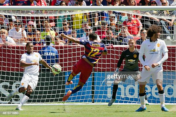 Rafinha of FC Barcelona scores against goalkeeper David De Gea and Antonio Valencia of Manchester United in the 90th minute during the International...