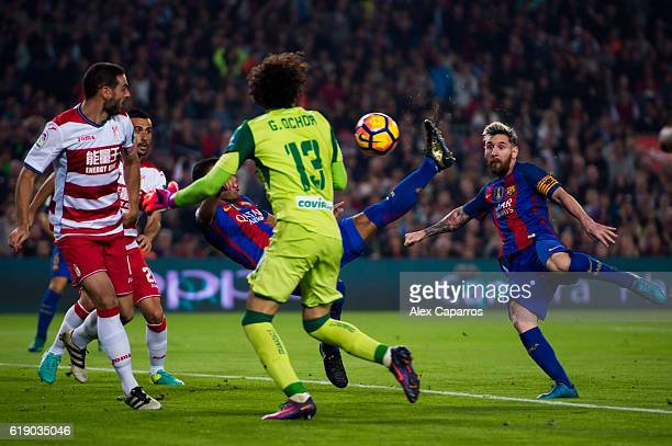 Rafinha of FC Barcelona scores the opening goal with an overhead kick during the La Liga match between FC Barcelona and Granada CF at Camp Nou...