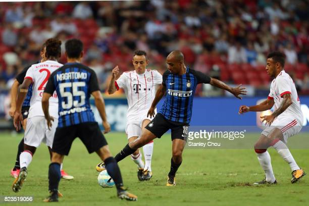 Rafinha of FC Bayern battles with Joao Mario of FC Internazionale during the International Champions Cup match between FC Bayern and FC...