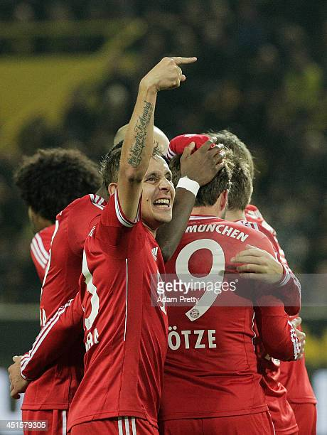 Rafinha of FC Bayern celebrates after Mario Gotze of FCBayern scores a goal during the Bundesliga match between FC Bayern and Bor Dortmund Signal...