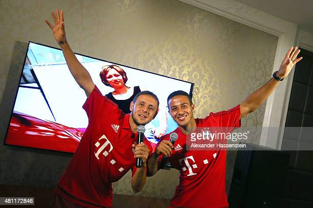 Rafinha of FC Bayern Muenchen and his team mate Thiago singing Karaoke at the team Inter Continental Beijing Beichen Hotel during day 2 of the FC...